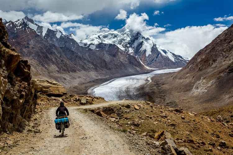 Cycling in Himalayas. Pensi La Pass over Drang Drung Glacier