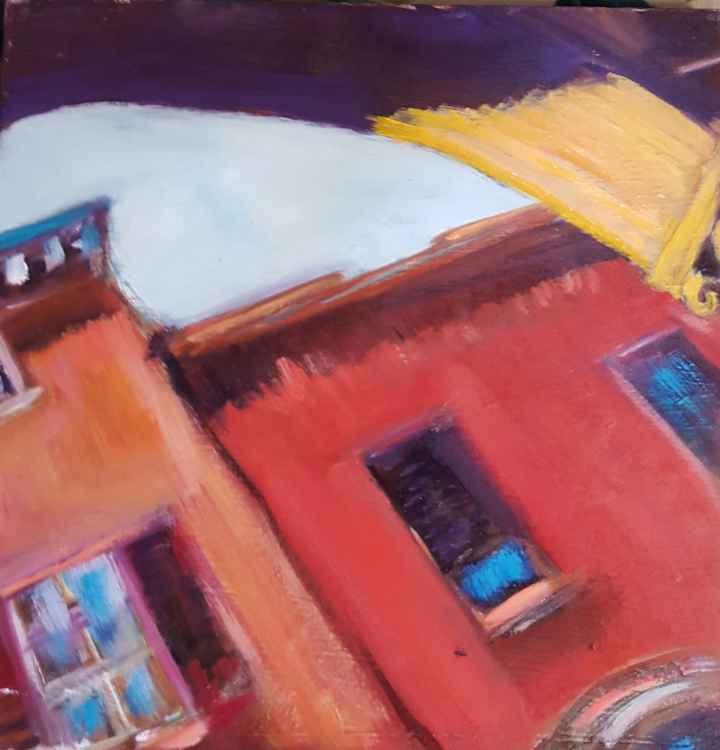 Looking up at Balogna buildings -