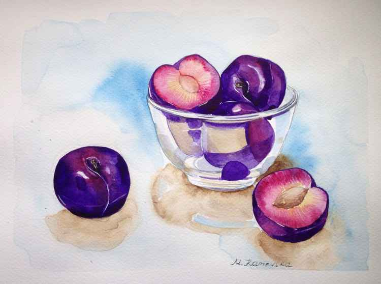 Still life with plums in a bowl