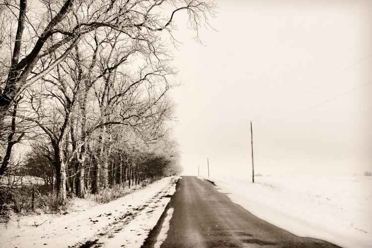 Winter Worlds on a Prairie Road -