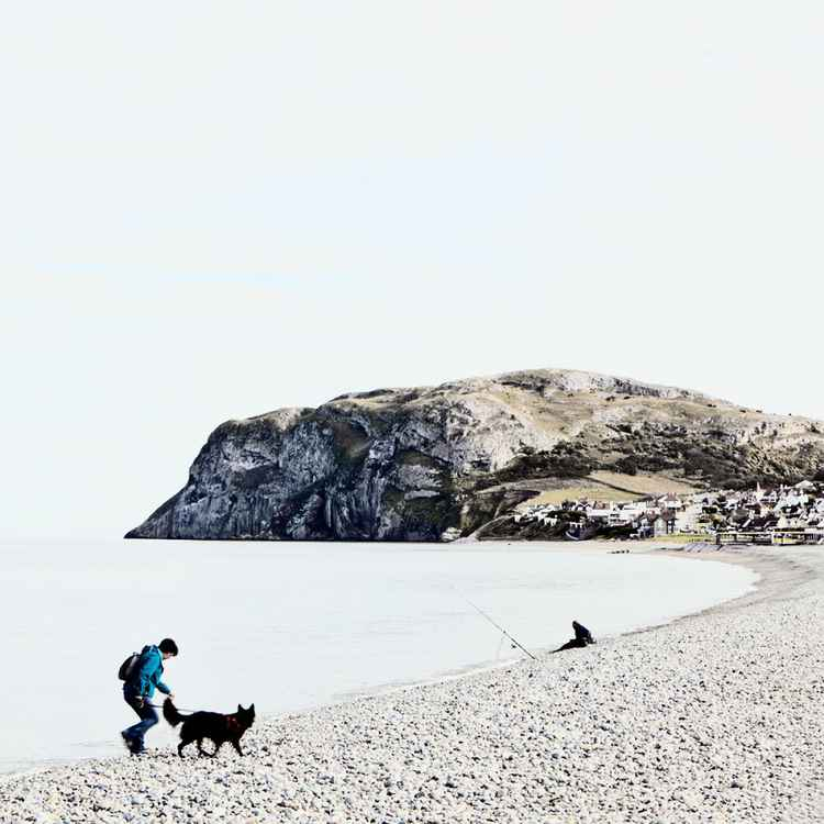 Dog walker & fisherman at Llandudno -