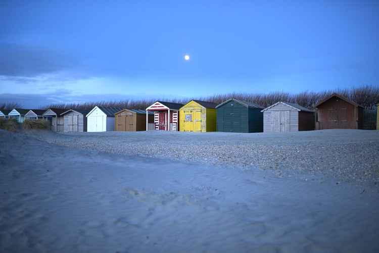 Beach huts in moonlight
