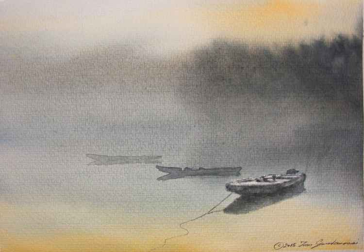 Three boats in the morning mist