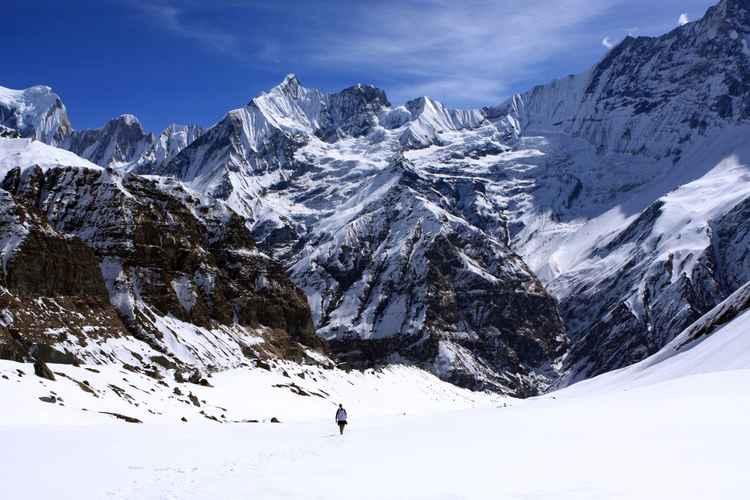 Hiker In Mountain Landscape