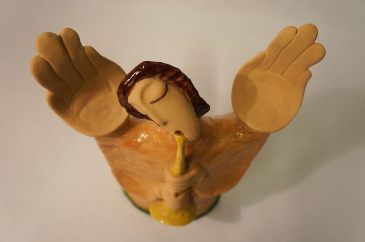 Reed-piping angel - Image 0