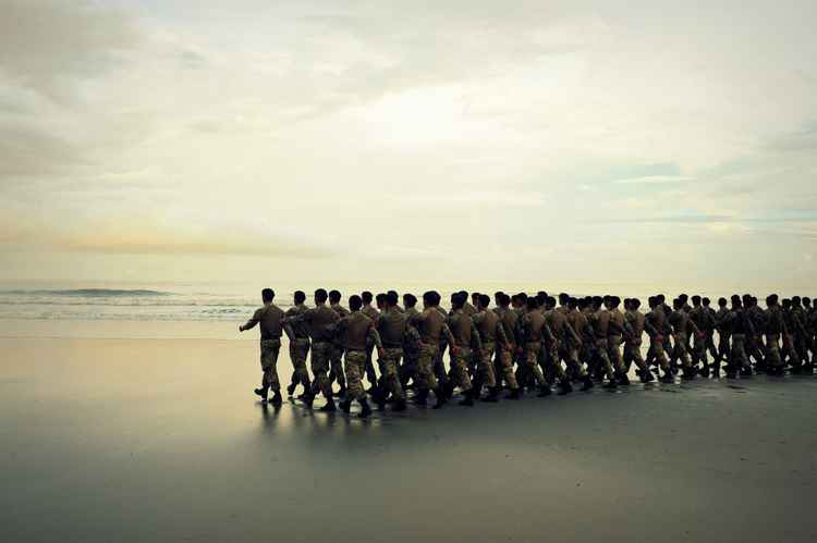 Gurkhas lining up on a Brunei beach during training