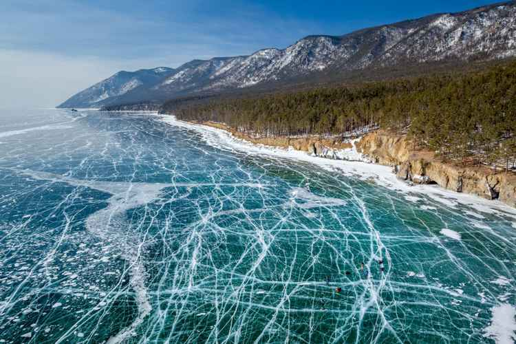 Icy web. Ice skating on lake Baikal -