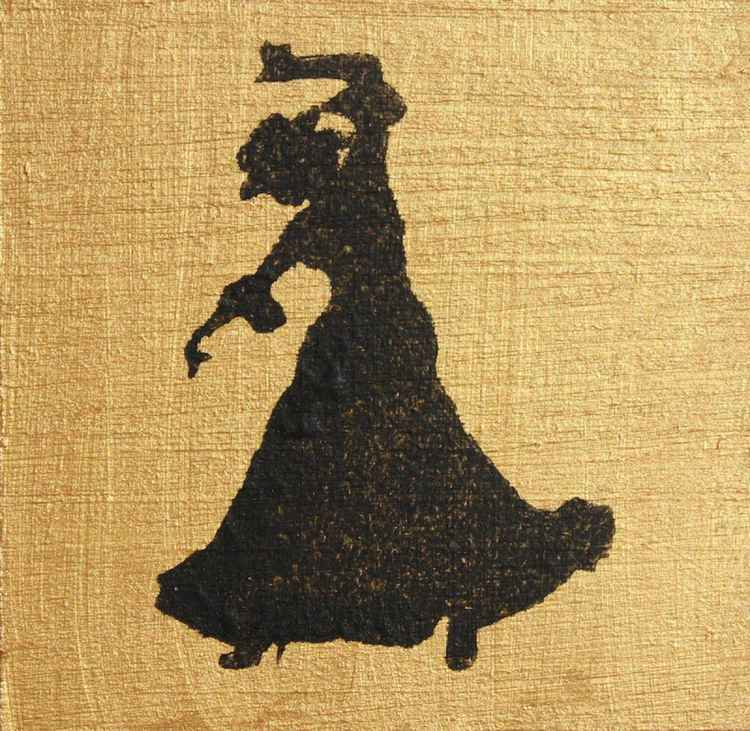Flamenco dancer on gold