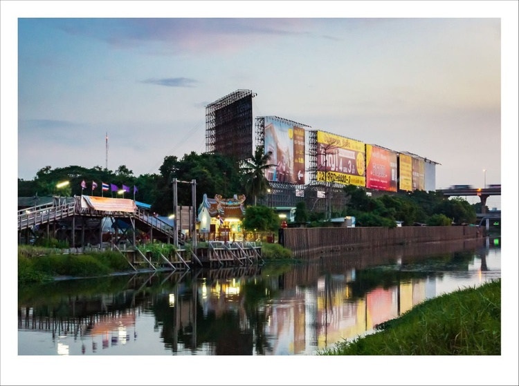 Chinese shrine along a canal during sunset. - Image 0
