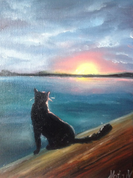 The cat's looking at the sunset - Image 0