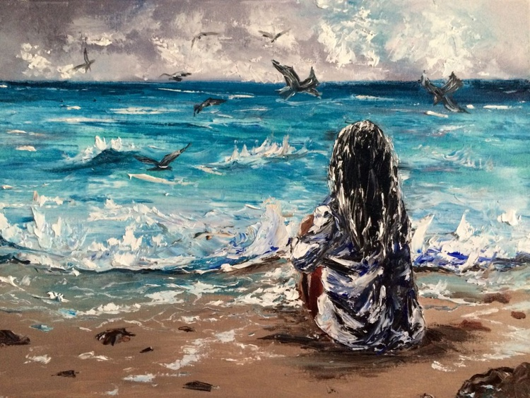 Girl sitting on the beach daydreaming - Image 0