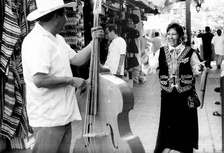 Mujer Bailando Feliz, Olvera Street, c. 2000 • Victor Herminio Lopez • Matt Print -