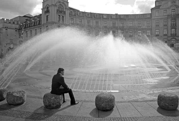 Man at Stachusbrunnen in Munich -