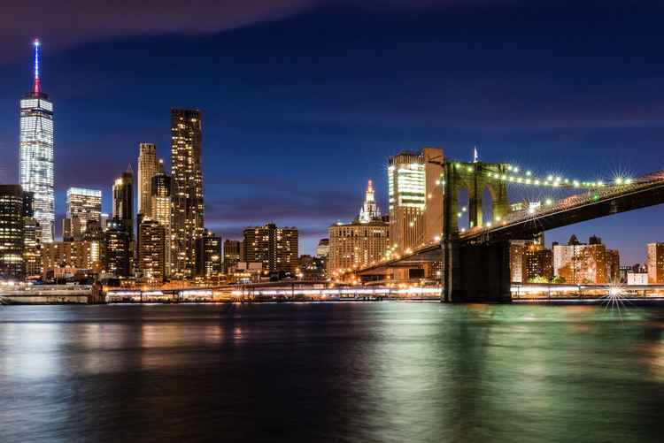 New York, Manhattan skyline sunset and Brooklyn Bridge -
