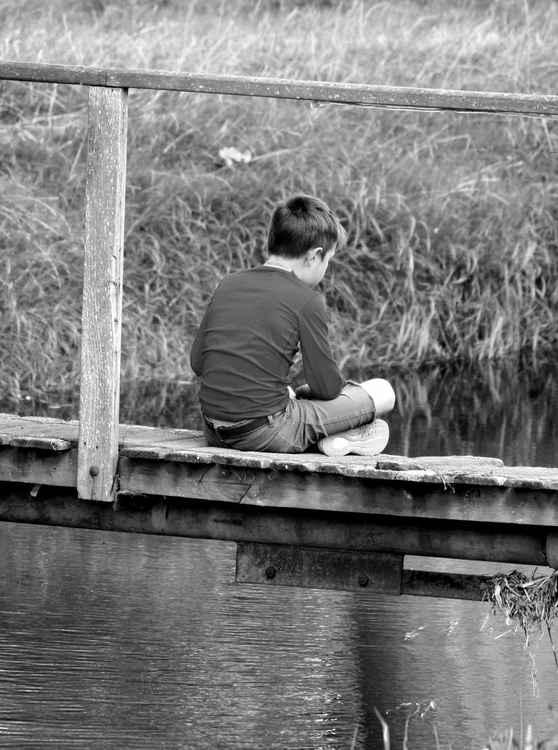 BOY ON A BRIDGE.