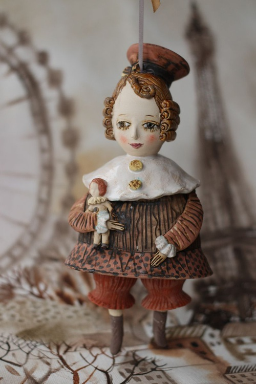 "Vintage girl with a doll. From ""Le Carousel, Hommage à l'Innocence"" project by Elya Yalonetski - Image 0"