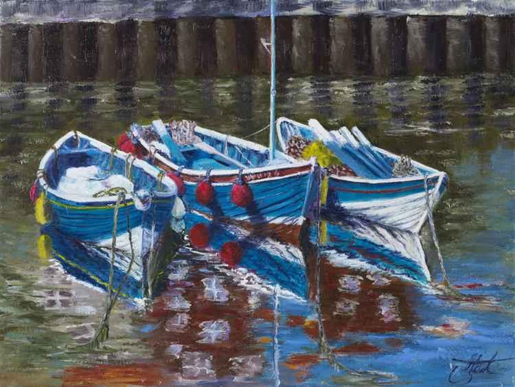 Three boats waiting at Whitby -