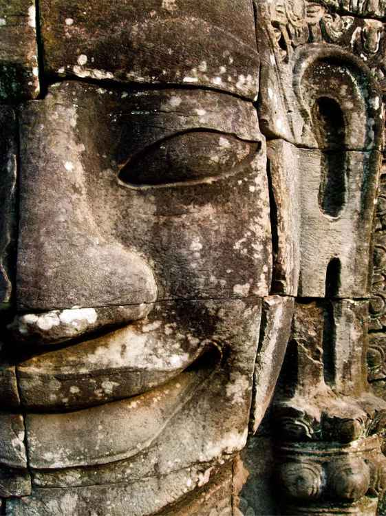 FACE AT THE BAYON, KINGDOM OF ANGKOR, CAMBODIA -