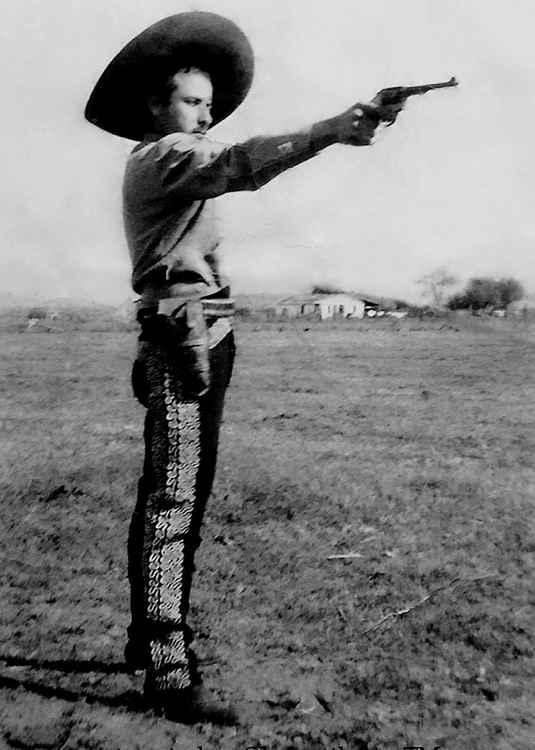 Lupe y Su Pistola, c. 1948 • Herminio Lopez, Foto Estudio Viena, Jalisco, Mexico • Ltd Edit. Silver Rag Print