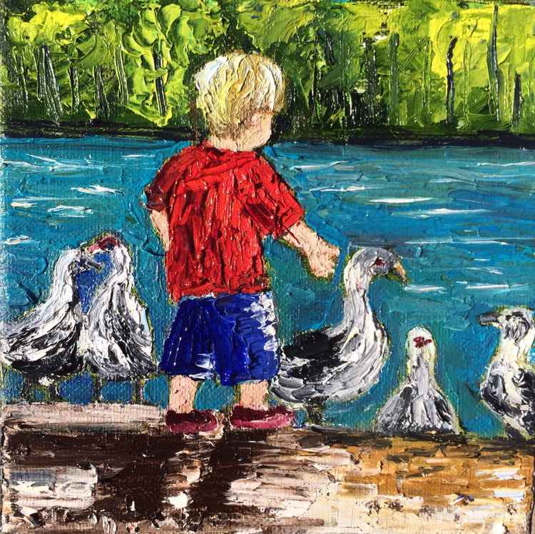 Boy with the ducks