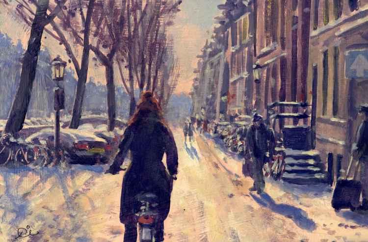 Emma biking in Amsterdam -