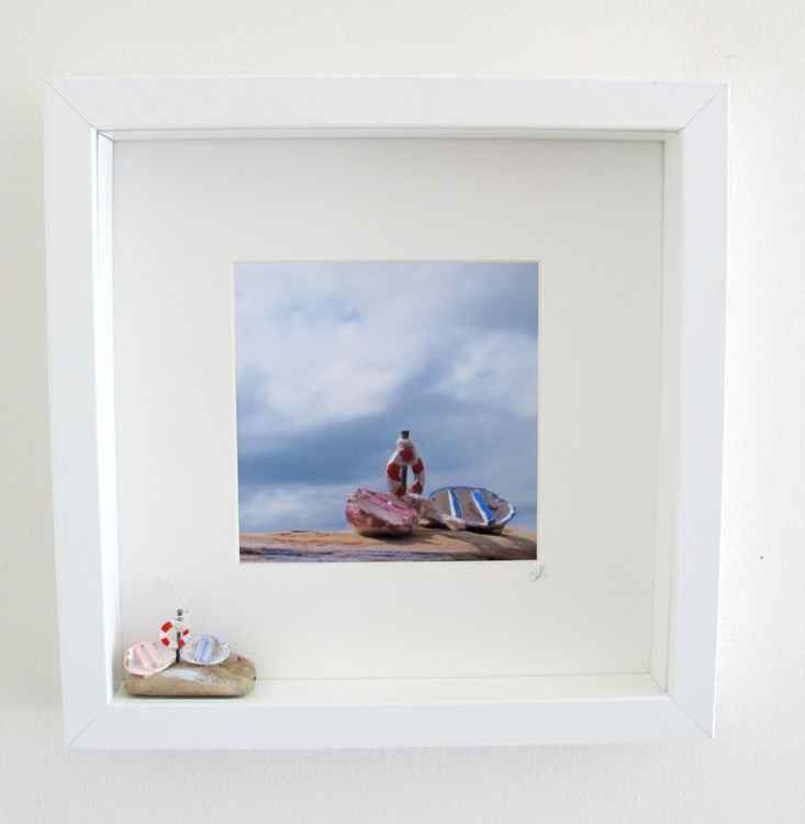 box set of driftwood boats and art sculpture photo