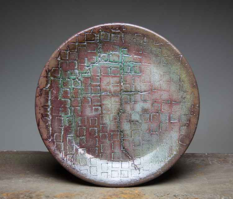 Round ceramic plate -