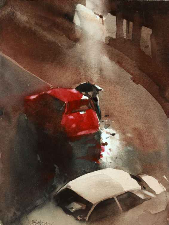 Red car in rainy night