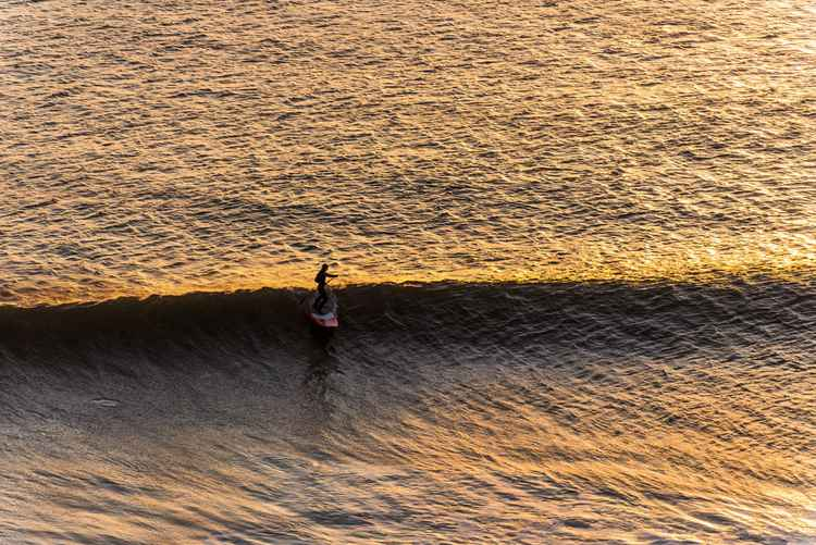 SUNSET SURFING -