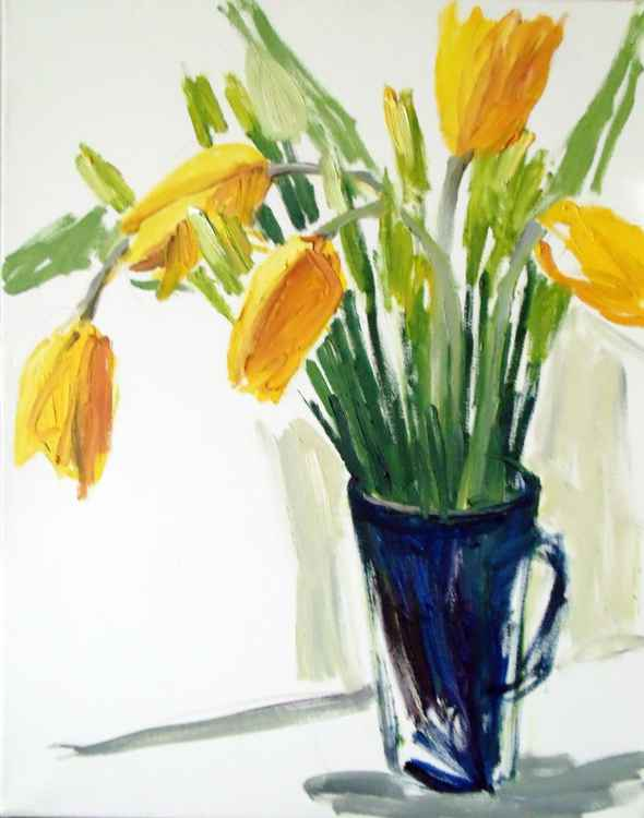 Yellow flowers in the blue jug -