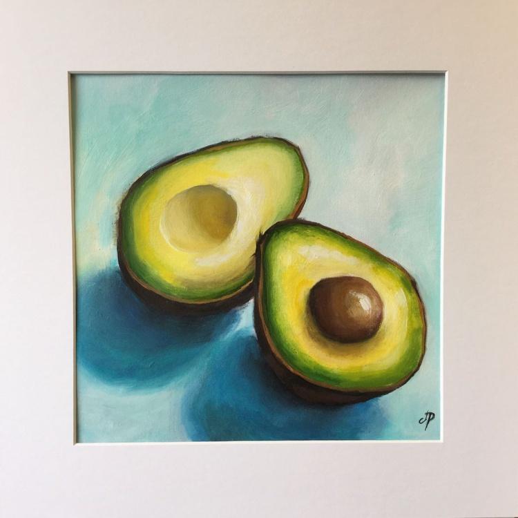Avocado halves on blue - Image 0