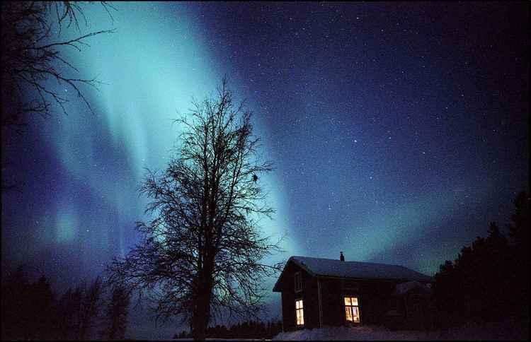 Aurora Borealis, northern lights over Laddon the arctic cabin -