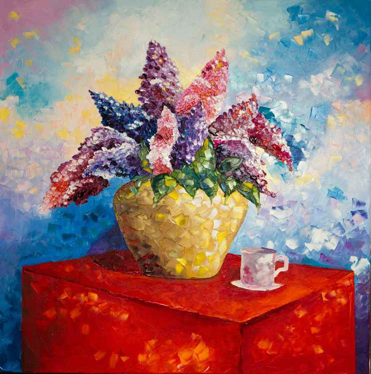Lilac on a red table