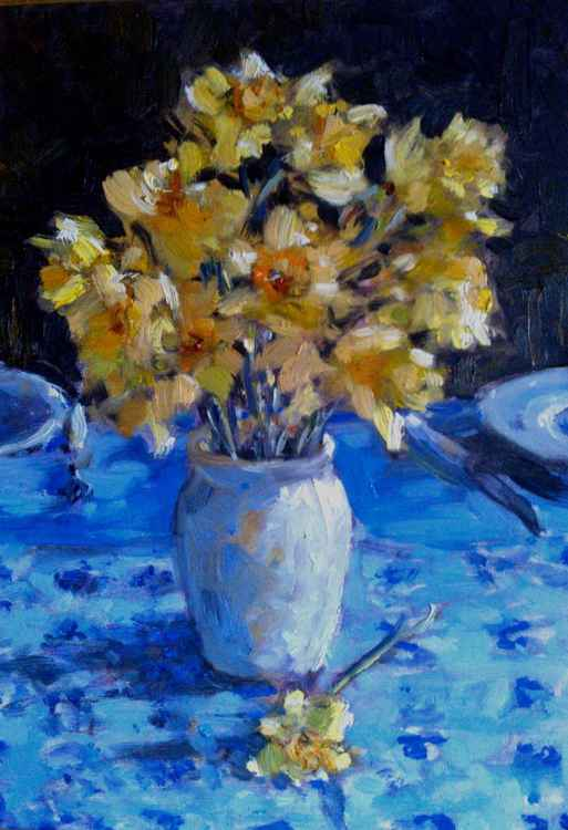 still life with flowers on blue background