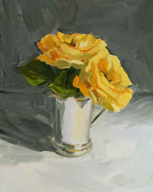 Yellow roses in silver cup -