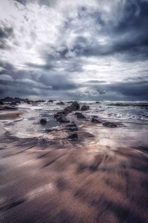 Duck pool beach on a stormy day in Cornwall England UK -