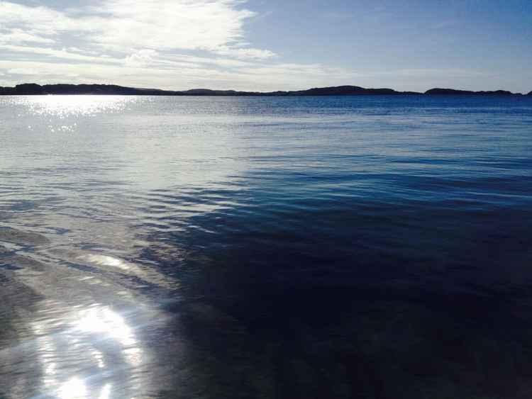 Reflecting sun on Iona