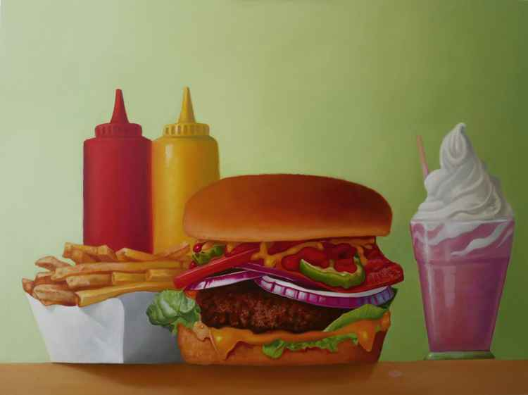 Still life with cheeseburger and fries -