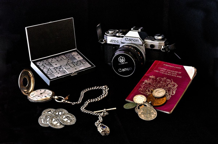 Still life retro travel themed with film camera, passport, games, money and timepiece - Image 0