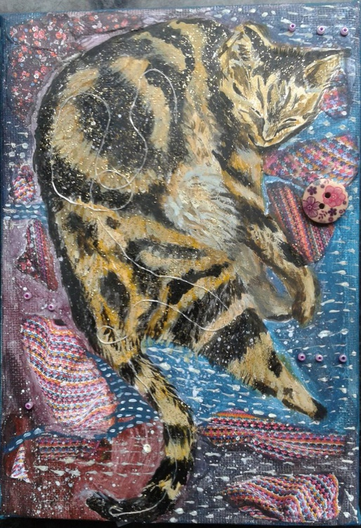 Cat amongst blankets - Image 0
