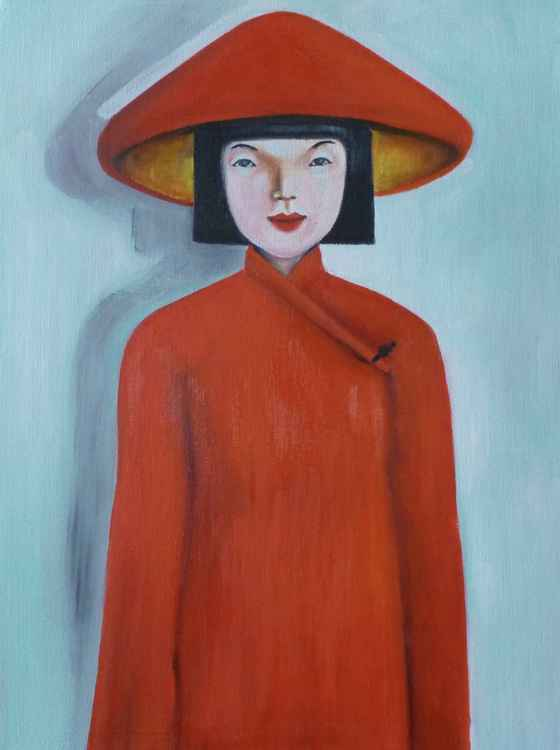 Vietnamese lady wearing a red hat -