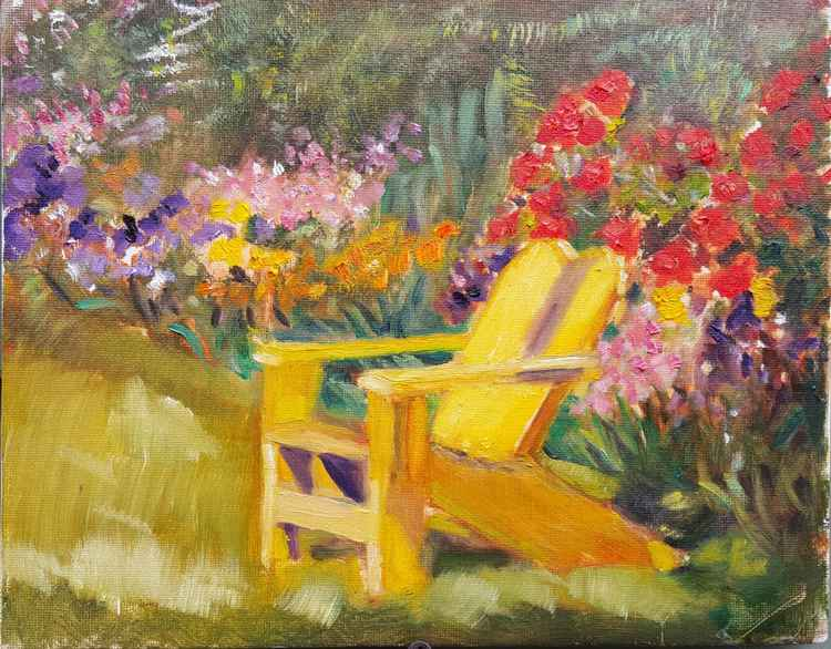Yellow chair in riot of flowers -