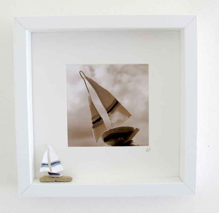 Box set with driftwood dinghy and art sculpture photo
