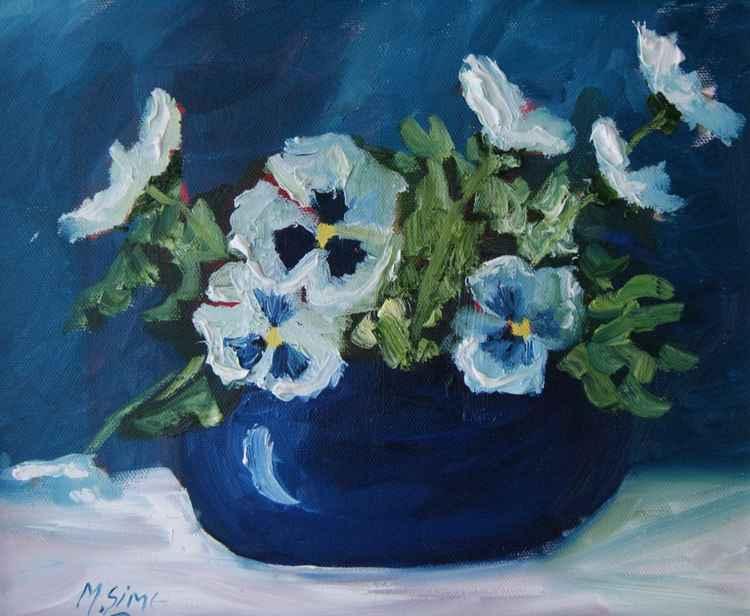 Pansies in blue pot